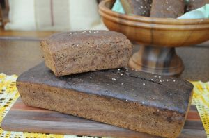 Two sizes rye bread on the cutting board