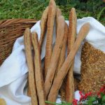 bread sticks and seed crackers in the basket