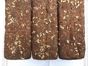 three loaves of seeded rye