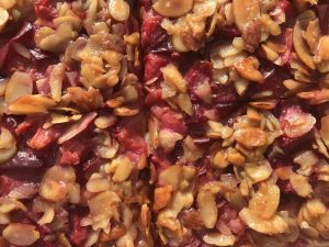 Closeup of fruit tart with almonds