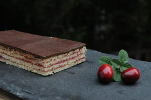 layered cookie on cutting board