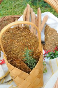 rye seed crackers in the basket + bread sticks